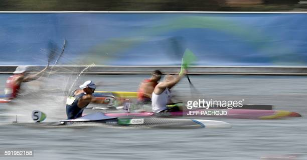 Germany's Ronny Rauhe and Britain's Liam Heath compete in the Men's Kayak Single 200m event at the Lagoa Stadium during the Rio 2016 Olympic Games in...