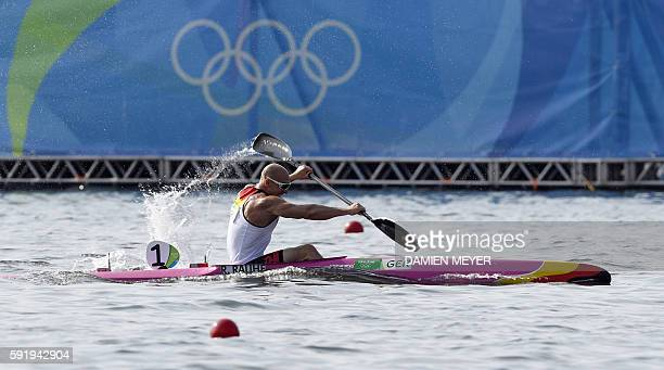 Germany's Ronny Rauhe competes in the Men's Kayak Single 200m event at the Lagoa Stadium during the Rio 2016 Olympic Games in Rio de Janeiro on...