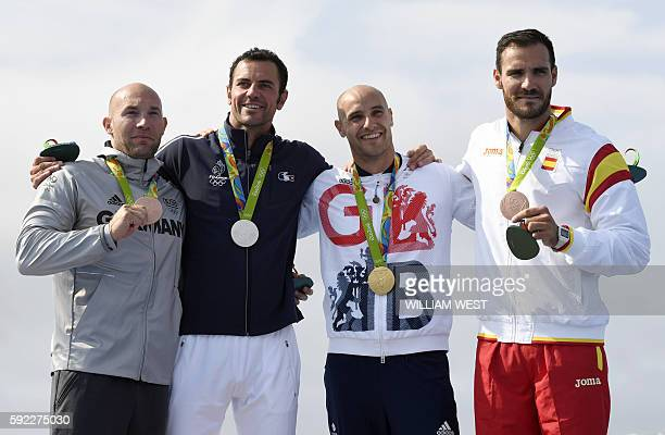 Germany's Ronny Rauhe France's Maxime Beaumont Britain's Liam Heath Spain's Saul Craviott celebrate on the podium of the Men's Kayak Single 200m...