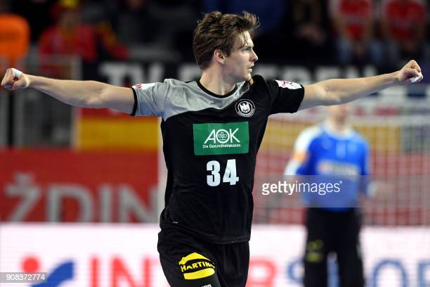 Germany's Rune Dahmke celebrates after scoring a goal during the group II match of the Men's 2018 EHF European Handball Championship between Germany...
