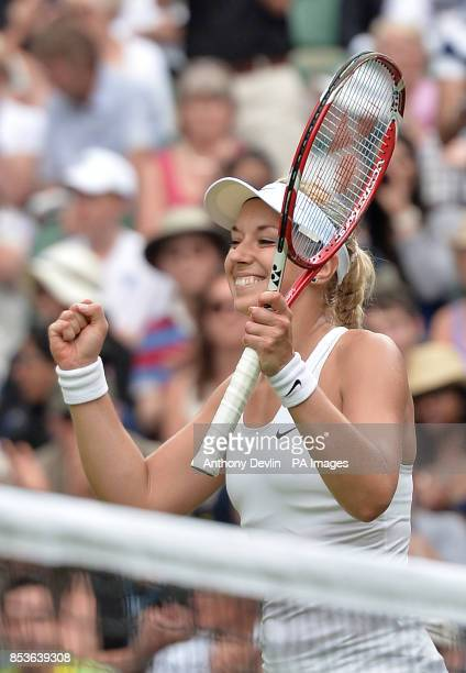 Germany's Sabine Lisicki celebrates defeating Israel's Julia Glushko during day two of the Wimbledon Championships at the All England Lawn Tennis and...