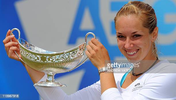 Germany's Sabine Lisicki holds the Maud Watson trophy after beating Slovakia's Daniela Hantuchova 63 62 during the final of the WTA AEGON Classic...