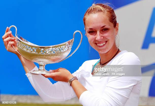 Germany's Sabine Lisicki holds up the Maud Watson trophy after defeating Slovakia's Daniela Hantuchova 63 62 in the AEGON Classic Final at Edgbaston...