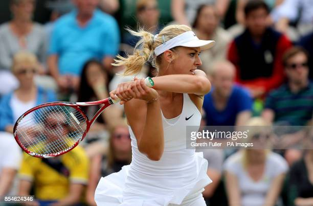 Germany's Sabine Lisicki in action against Czech Republic's Karolina Pliskova during day four of the Wimbledon Championships at the All England Lawn...