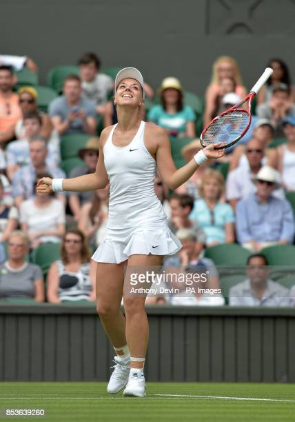 Germany's Sabine Lisicki reacts in her match against Israel's Julia Glushko during day two of the Wimbledon Championships at the All England Lawn...
