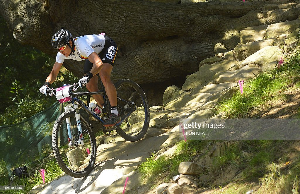 Germany's Sabine Spitz tackles a steep d : News Photo