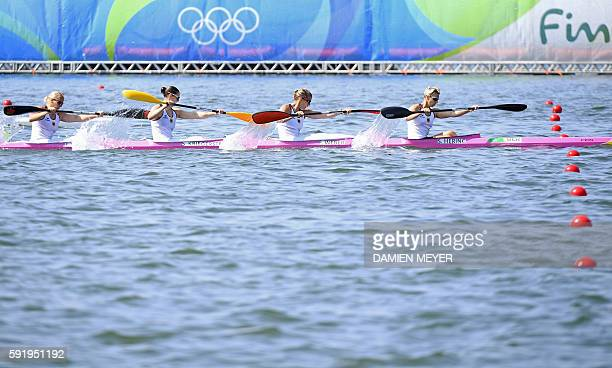 Germany's Sabrina Hering Germany's Franzi Weber Germany's Steffi Kriegerstein and Germany's Tina Dietze compete in the Women's Kayak Four 500m...