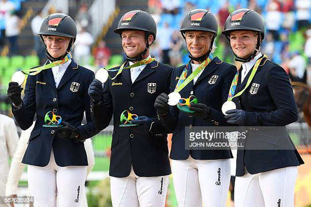 Germany's Sandra Auffarth, Germany's Michael Jung, Germany's Ingrid Klimke and Germany's Andreas Ostholt celebrates on the podium of the Eventing's...