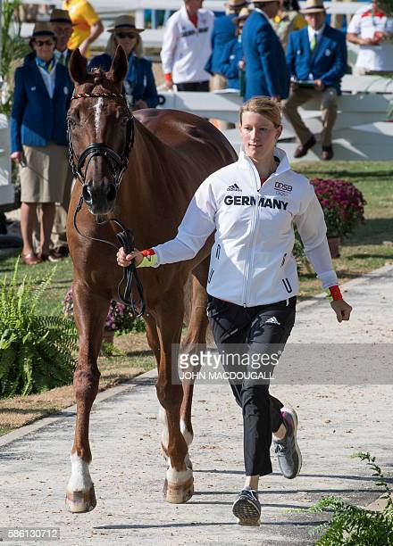 Germany's Sandra Auffarth leads Opgun Louvo to a trot during the first horse inspection of the Equestrian's Eventing phase during the 2016 Rio...