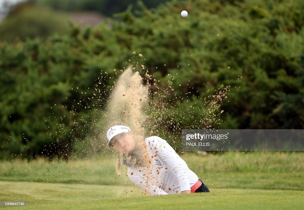 TOPSHOT - Germany's Sandra Gal plays out of a bunker on the 17th on the first day of the 2018 Women's British Open Golf Championships at Royal Lytham & St. Annes Golf Club, northwest England, on August 2, 2018.