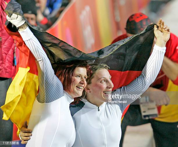 Germany's Sandra Kiriasis left and brakeman Anja Schneiderheinze celebrate after their gold medal finish in the Women's bobsled in Cesana Pariol...