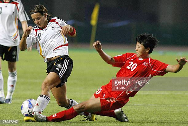 Germany's Sandra Smisek tackled hard by North Korea's Hong Myong Gum during their quarterfinal of the FIFA Women's Football World Cup in Wuhan in...