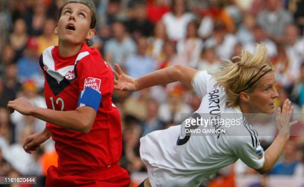 Germany's Saskia Bartusiak and Canada's Christine Sinclair vie for the ball during the opening match of the FIFA women's football World Cup Germany...