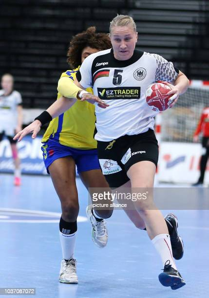 Germany's Saskia Lang in action against the Congo's Christianne Mwange Mwasesa during a handball match between Germany and the DR Congo at the IHF...