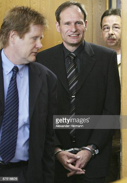 Germany's selfconfessed cannibal Armin Meiwes enters accompanied by his lawyer Harald Ermel the courtroom for his retrial for murder on 03 May 2006...