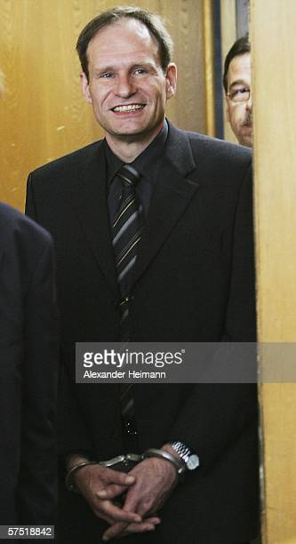 Germany's selfconfessed cannibal Armin Meiwes enters the courtroom for his retrial for murder on 03 May 2006 at court in Frankfurt Germany in which...