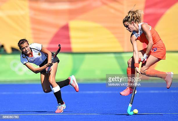 Germany's Selin Oruz and Netherlands' Ellen Hoog vie during the women's field hockey Netherland's vs Germany match of the Rio 2016 Olympics Games at...