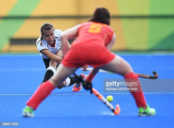 Germany's Selin Oruz tries to hit past China's Li Jiaqi during the women's field hockey China vs Germany match of the Rio 2016 Olympics Games at the...