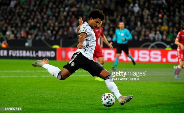 Germany's Serge Gnabry kicks the ball during the UEFA Euro 2020 Group C qualification football match between Germany and Belarus on November 16 2019...