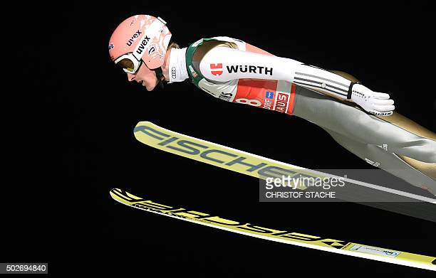 Germany's Severin Freund soars through the air during his qualification jump of the ski jumping event in Oberstdorf southern Germany which is the...