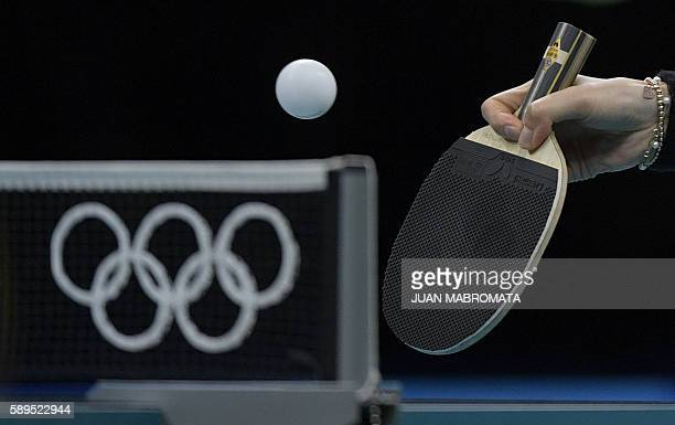 Germany's Shan Xiaona hits a shot in the women's team semi-final table tennis match against Japan at the Riocentro venue during the Rio 2016 Olympic...