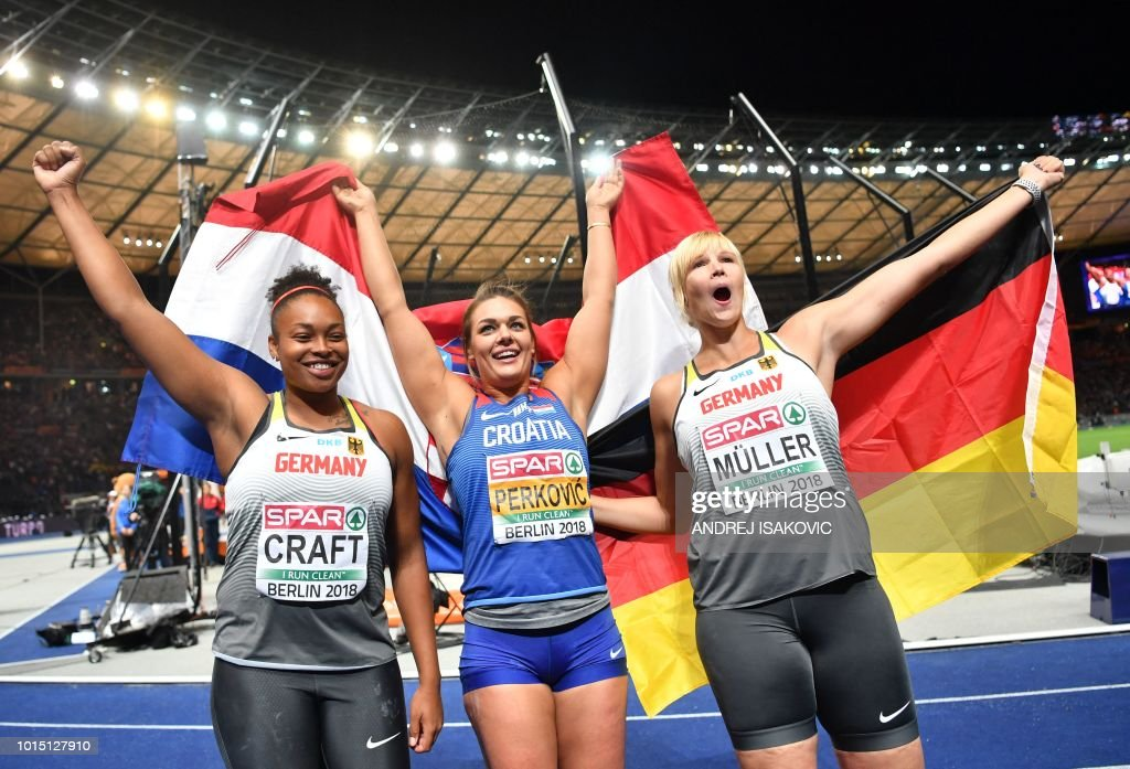 Germany's Shanice Craft (3rd), Croatia's Sandra Perkovic (1st) and Germany's Nadine Mueller (2nd) celebrate after the women's Discus Throw final during the European Athletics Championships at the Olympic stadium in Berlin on August 11, 2018.