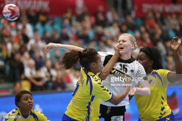 Germany's Shenia Minevskaja in action against the Congo's defence during a handball match between Germany and the DR Congo at the IHF Women's...