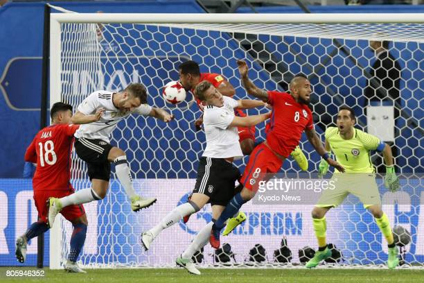 Germany's Shkodran Mustafi heads the ball during the second half of the Confederations Cup final against Chile in St Petersburg on July 2 2017...