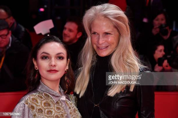 Germany's shooting star Emma Drogunova poses on the red carpet with US film producer Martha De Laurentiis ahead of the screening for the film Vice at...