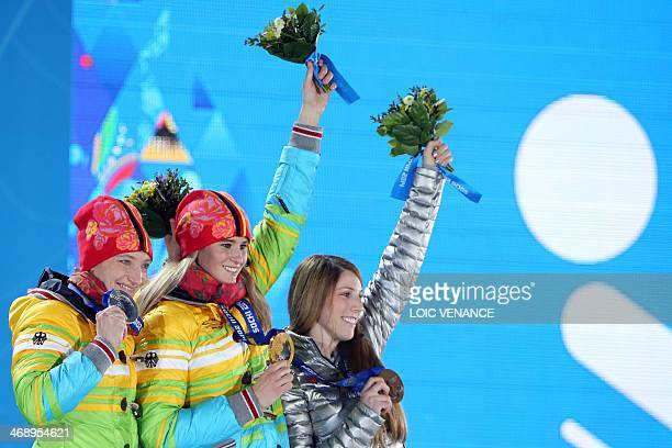Germany's silver medalist Tatjana Huefner Germany's gold medalist Natalie Geisenberger and US bronze medalist Erin Hamlin pose during the Women's...