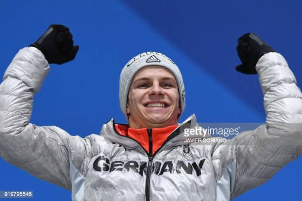 Germany's silver medallist Andreas Wellinger poses on the podium during the medal ceremony for the men's ski jumping large hill individual at the...