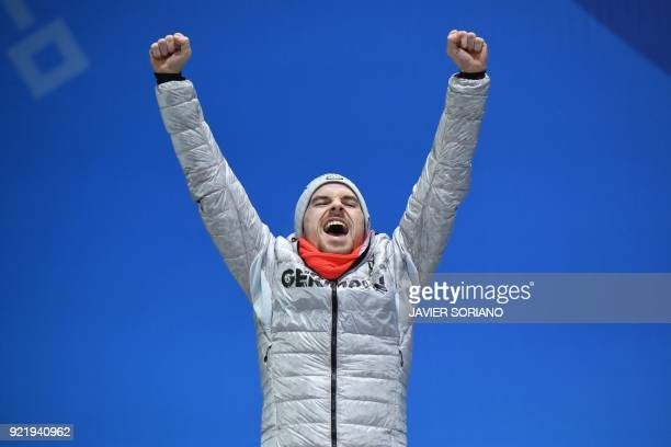 Germany's silver medallist Fabian Riessle poses on the podium during the medal ceremony for the nordic combined Individual Gundersen LH/10km at the...