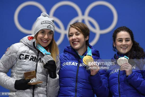 Germany's silver medallist Jacqueline Loelling Britain's gold medallist Lizzy Yarnold and Britain's bronze medallist Laura Deas pose on the podium...