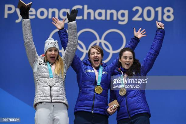 TOPSHOT Germany's silver medallist Jacqueline Loelling Britain's gold medallist Lizzy Yarnold and Britain's bronze medallist Laura Deas pose on the...