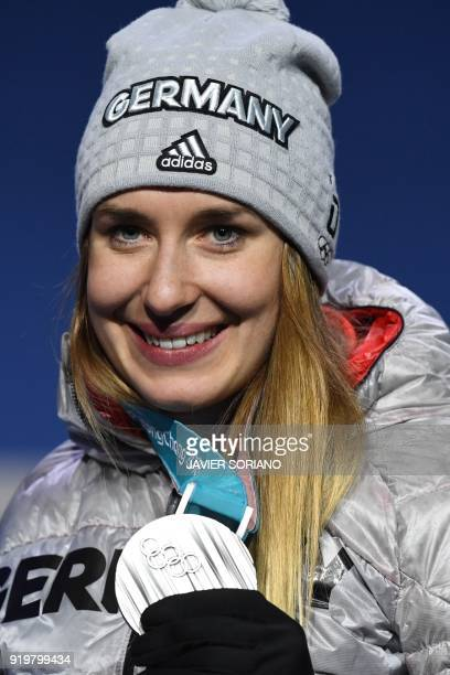 Germany's silver medallist Jacqueline Loelling poses on the podium during the medal ceremony for the women's skeleton at the Pyeongchang Medals Plaza...