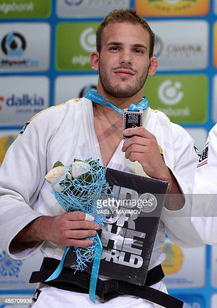 Germanys silver medallist KarlRichard Frey poses with his medal following the mens 100kg category competition at the Judo World Championships in...