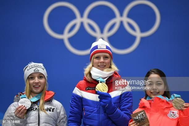 Germany's silver medallist Katharina Althaus Norway's gold medallist Maren Lundby and Japan's bronze medallist Sara Takanashi pose on the podium...