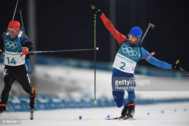 TOPSHOT Germany's Simon Schempp and France's Martin Fourcade cross the finish line in the men's 15km mass start biathlon event during the Pyeongchang...