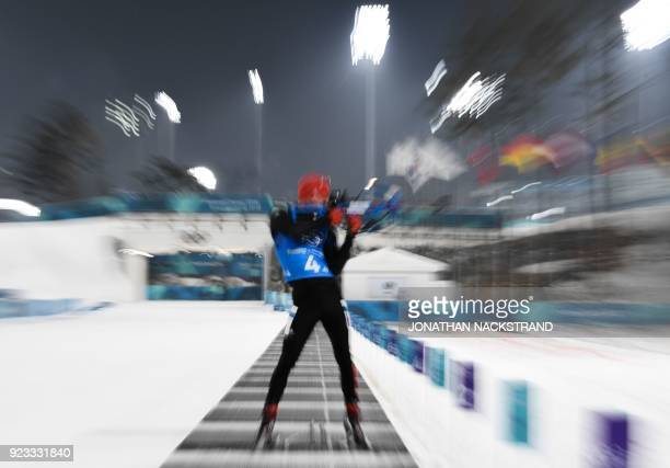 TOPSHOT Germany's Simon Schempp competes at the shooting range in the men's 4x75km biathlon event during the Pyeongchang 2018 Winter Olympic Games on...