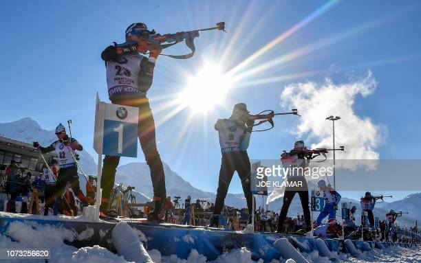 TOPSHOT Germany's Simon Schempp France's Simon Desthieux and Norway's Sindre Pettersen take part in a practice session at the shooting range before...