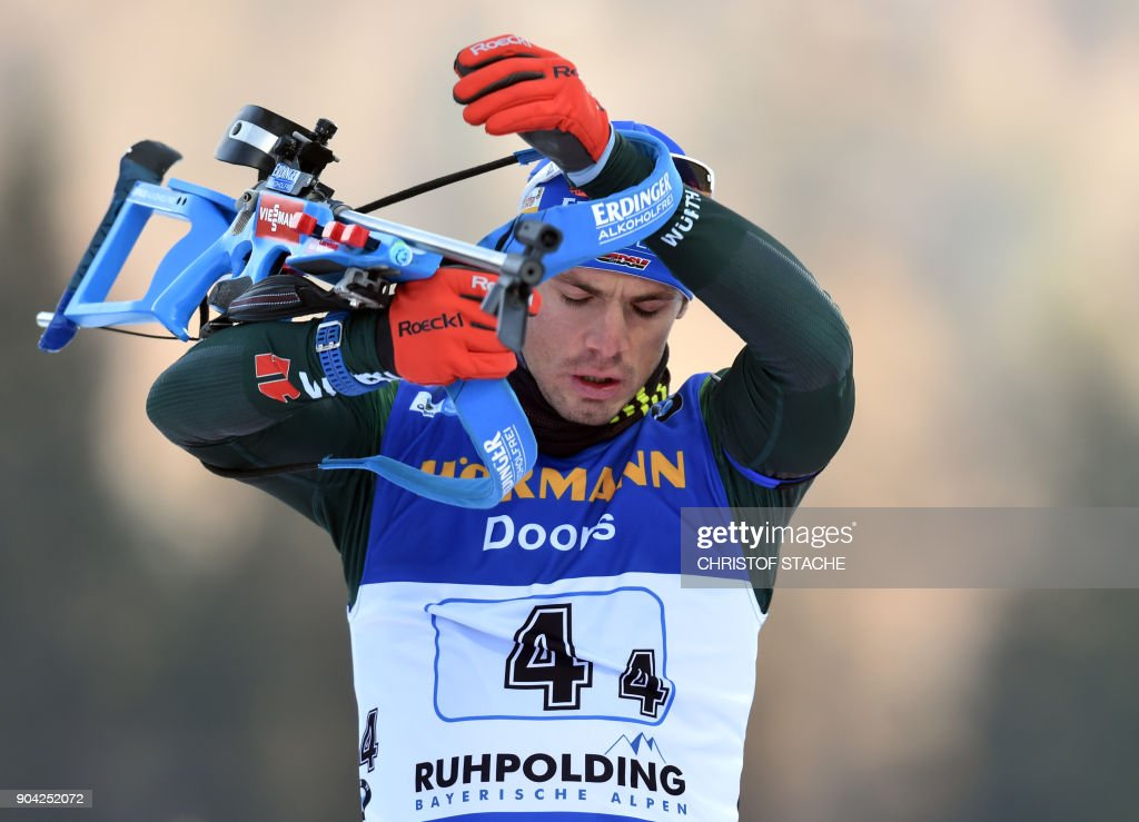Germany's Simon Schempp reacts during the warm up shooting prior to the men's 4 x 7,5km relay event at the Biathlon World Cup on January 12, 2018 in Ruhpolding, southern Germany. /