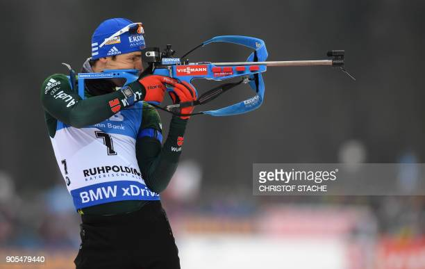 Germany's Simon Schempp shoots during the warmup shooting prior the men's 15 kilometer mass start competition at the Biathlon World Cup on January 14...