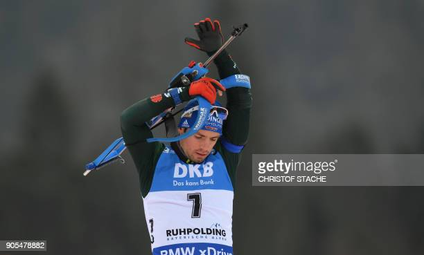 Germany's Simon Schempp shoulders his gun during the warmup shooting prior the men's 15 kilometer mass start competition at the Biathlon World Cup on...