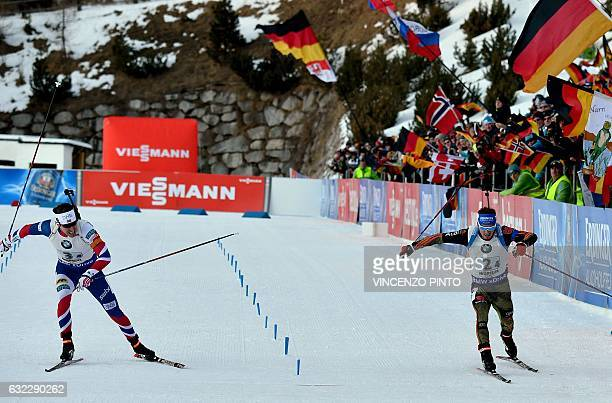 Germany's Simon Schempp sprint to win againt Norway's Emil Hegle Svendsen as they compete in the Biathlon World Cup Men's 4x75 km relay race in...