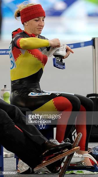 Germany's skater Anni Friesinger puts on her skates during the speedskating 1000m training ahead of the final tonight at the Richmond Olympic Oval in...