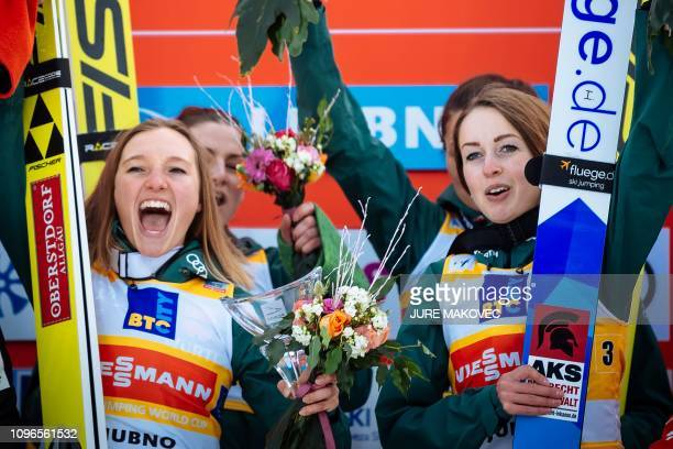 Germany's skiers Katharina Althaus Anna Rupprecht Carina Vogt and Juliane Seyfarth celebrate on the podium after winning in the FIS Ladies Ski...