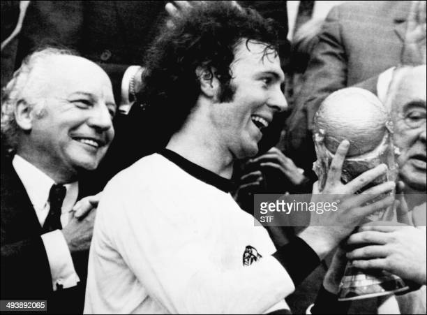 Germany's soccer star and team captain Franz Beckenbauer receives the World Soccer Cup won by his team after a 21 victory over Holland 07 July 1974...