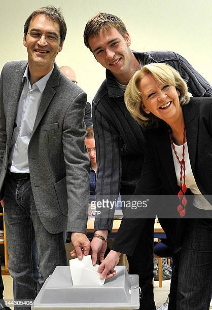 Germany's SPD Party top candidate Hannelore Kraft gives her vote with son Jan Kraft and husband Udo Kraft at the German regional elections of north...
