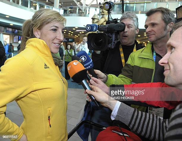 Germany's speed skater Anni Friesinger gives a statement to journalists upon her arrival at Vancouver Airport on February 8, 2010 for the Vancouver...