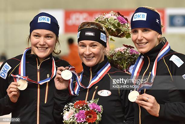Germany's speed skaters Gabriele Hirschbichler Claudia Pechstein and Bente Kraus pose with their bronze medals during the awards ceremony of the...